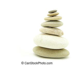 balanced stones - Stack of balanced stones on a white...