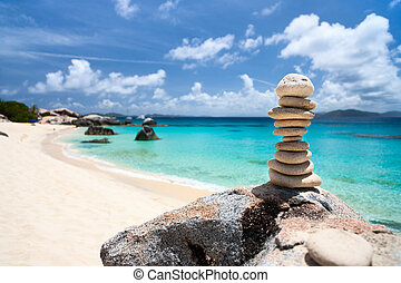 Stack of balances stones at tropical beach