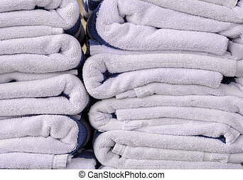 Stack of bath towels on wooden table