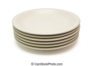 Stack of beige dinner plates isolated