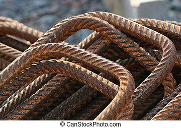 Stack of bent rusty rebars - A pile of rusty, bent and rebar