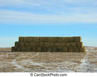 stack of big hay bales