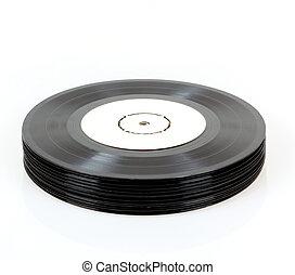 stack of black vinyl records