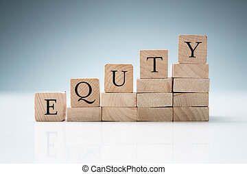 Stack Of Blocks Arranged In A Row Showing Equity Text