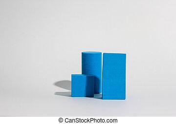 Stack of blue blocks. Geometrical figures still life ...