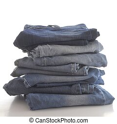 stack of blue jeans, isolated on white background
