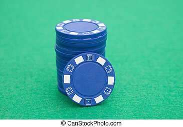 stack of blue poker chips on casino table