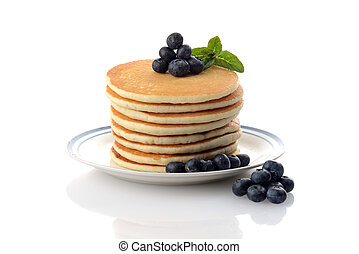 stack of blueberry pancakes with mint on white