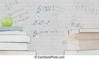 Stack of books and apple against mathematical equations on ...