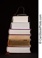 Stack of books on the black background