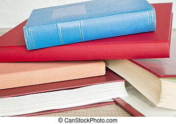 stack of books on the floor
