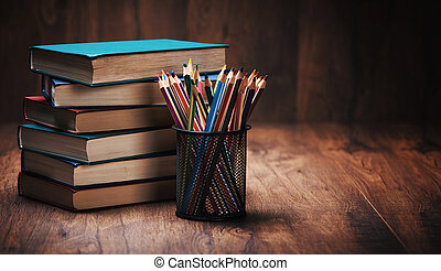 Stack of books on the wooden table