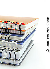 stack of books  - stack of various color ring binding books