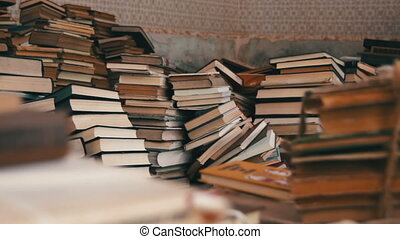Stack of Books Scattered on the Floor in the Library