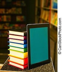 Stack of books with a tablet PC