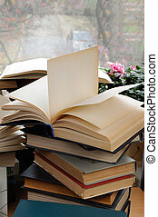 Stack of books with an open book on top of a close-up