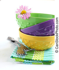 Stack of bowls and forks