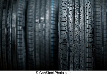Stack of brand new high performance car tires