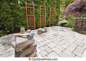 Stack of Brick Pavers for Hardscape in Backyard Landscaping...