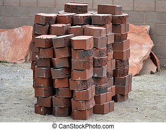 Stack of bricks for retaining wall - stack of red charcoal...