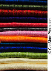 Stack of brightly coloured fluffy alpaca blankets