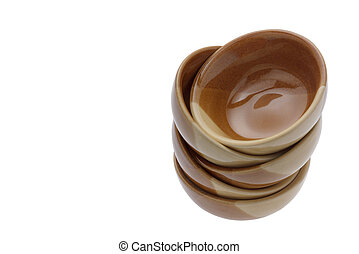 stack of brown bowls isolated on white background. clipping path.