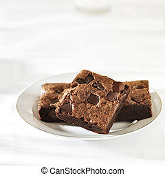 Stack of brownies on a plate with copy space composition
