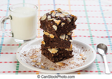 stack of brownies on white plate