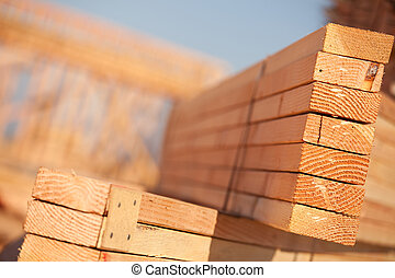 Stack of Building Lumber at Construction Site with Narrow...