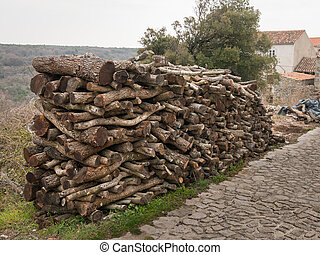 Stack of burning wood near Lubenice on a cloudy day in spring