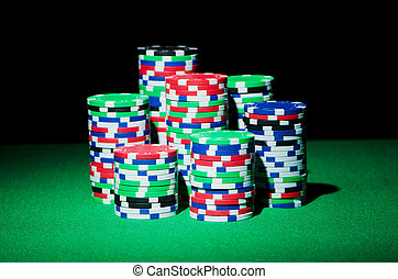 Stack of casion chips on table