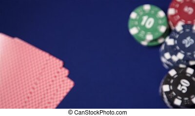 Stack of chips and four aces on blue felt