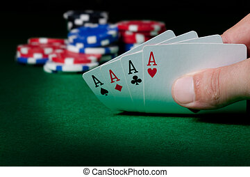 four aces - Stack of chips and four aces