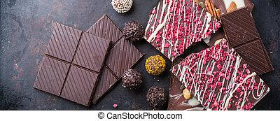 Stack of chocolate bars and praline truffle