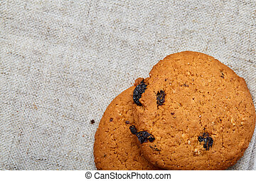 Stack of Chocolate chip cookies on wooden background. Stacked chocolate chip cookies shot with selective focus.