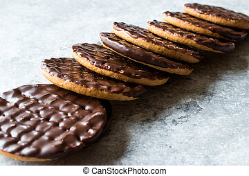 Stack of Chocolate Covered Round Jaffa Cookies / Whole Wheat.