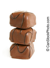 Stack of chocolate sweets on a white background