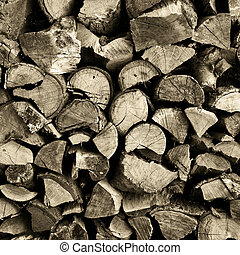 Stack of chopped and split firewood logs arranged. - Stack...