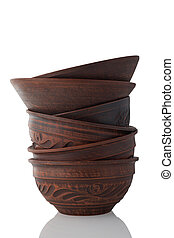 Stack of clay bowls isolated on white background.