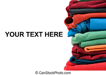 Stack of color clothes stored in rows