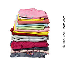 close up of stack of shirts and other clothes on white background with clipping path