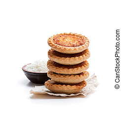 Stack of coconut tarts isolated on white