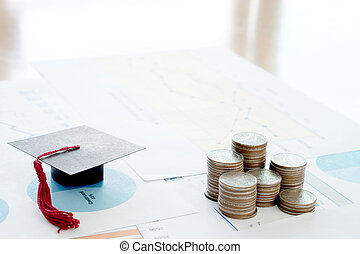 Stack Of Coins And A Black Mortarboard