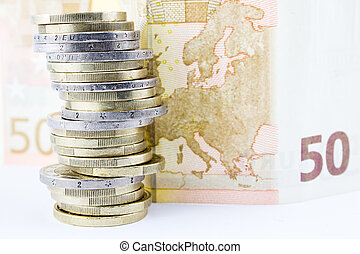 Stack of coins and banknote