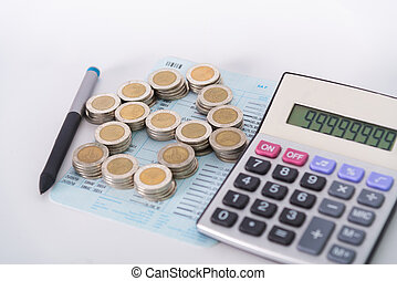 Stack of coins as house shape and calculator on the account book on white background.