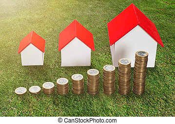 Stack Of Coins In Front Of House Model