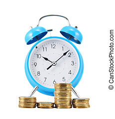 Stack of coins in front of the alarm clock