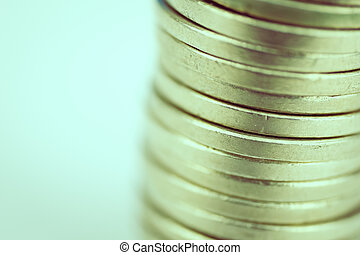 Stack of coins on a white background. Close up. toned