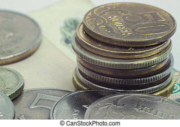 stack of coins on the banknote