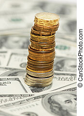 Stack of coins on the dollar background